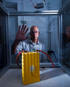 At the Battery Abuse Testing Laboratory (BATLab), a Sandia researcher prepares to test a battery pack to determine its response under abuse conditions.