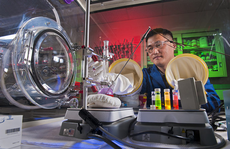 Sandia's Hongyou Fan works with nanocoatings in his lab. (Photo by Randy Montoya)
