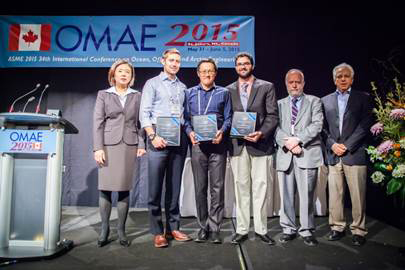 The OMAE 2015 Hydrodynamic Modeling Competition award ceremony at the ASME conference in St. Johns, Newfoundland, Canada. Sandia's Carlos Michelen is third from the right.