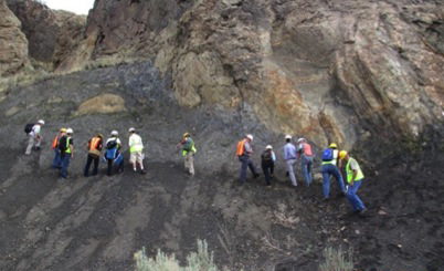 Shales at All Scales workshop participants examine Mancos shale, contact metamorphism features, and mineralized fractures.