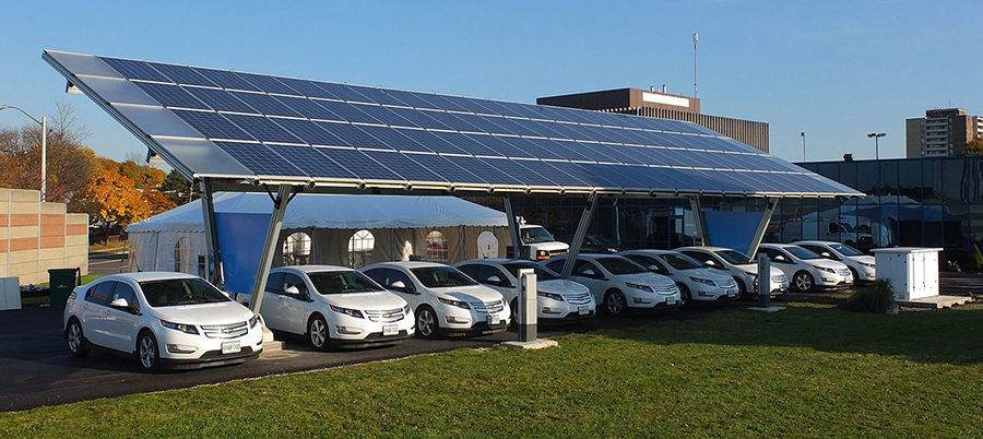 Fleet of Chevrolet Volts at a solar-powered charging station. (photo credit: Sass Peress, Renewz Sustainable Solutions Inc., Creative Commons 3.0)