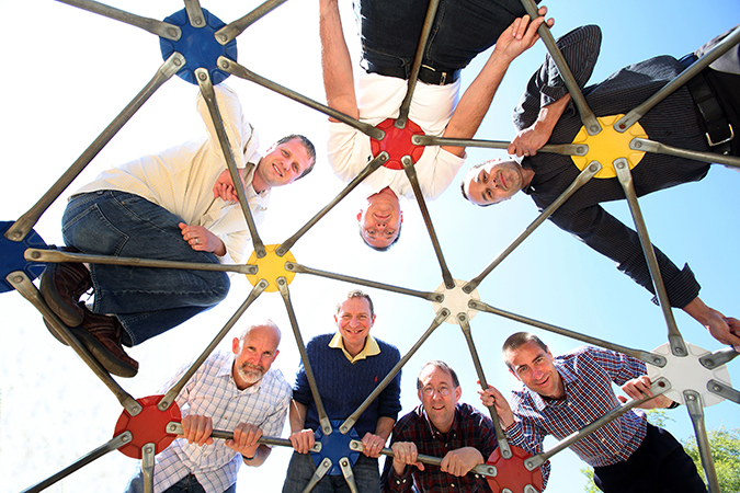 This playground structure represents a larger-than-life nanoporous metal-organic framework to this Sandia research team of (clockwise from upper left) Michael Foster, Vitalie Stavila, Catalin Spataru, François Léonard, Mark Allendorf, Alec Talin and Reese Jones. The team made the first measurements of thermoelectric behavior in a MOF. (Photo by Dino Vournas)