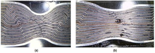 Internal faults exhibited by jelly-roll layers for pinch with 0.25 in ball (a) and 0.5 in ball (b).