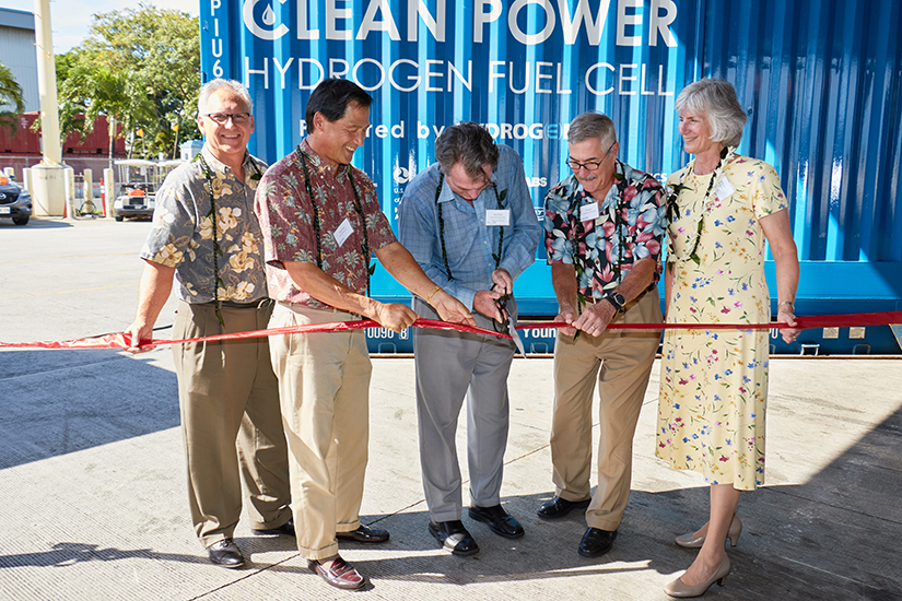 Pete Devlin, of the Department of Energy's Fuel Cell Technology Office, cut the ribbon to initiate the Maritime Hydrogen Fuel Cell project to test a hydrogen-fuel-cell-powered generator at Young Brothers Ltd.'s Port of Honolulu facility. Left to right: Mark Glick, Hawaii State Energy Office, Glenn Hong, Young Brothers Ltd., Pete Devlin, John Quinn, US Dept. of Transportation Maritime Administration, and Marianne Walck, Sandia National Laboratories.