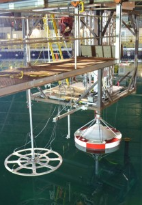 Model scale wave energy converter test device; sonic wave probe array shown in foreground.
