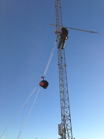 Miguel Hernandez (Texas Tech Univ. staff) servicing a SWiFT facility anemometer boom.