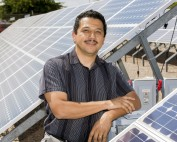 Researcher Abraham Ellis among the solar panels at Sandia National Laboratories
