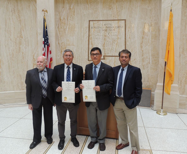 ROUNDHOUSE RECOGNITION — State legislators honored Sandia's Stan Atcitty and Hongyou Fan for their research. Posing at the Roundhouse are (left to right) Imre Gyuk, DOE program manager, Stan, Hongyou, and Babu Chalamala, manager, energy storage. (Photo by Mason J. Martinez)