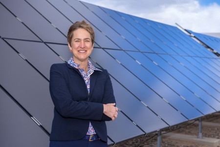 Amy Halloran shows off one of Sandia's solar research projects. Amy's mentoring activities were recognized by the New Mexico Technology Council.