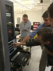 The project team from Sandia, Montana Technological University, and Bonneville Power Administration analyze results from a closed-loop test conducted at Celilo. (Photo courtesy of David Schoenwald)