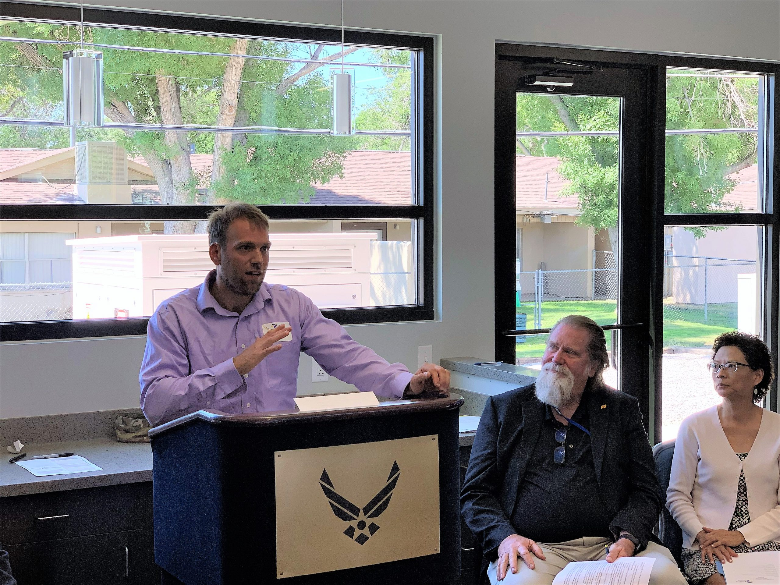 DC Microgrid PI Jack Flicker discusses Sandia and Emera's project and advantages of creating self-sustaining microgrids during the ribbon cutting for Phase one of the project at the new KAFB community center near the Base's temporary housing units. (Photo by Dan Ware)