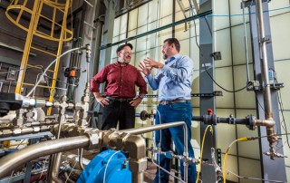 Sandia researcher Bobby Middleton, right, has developed a more efficient cooling system for power plants. Together with Patrick Brady, left, the researchers are also developing a first-of-its kind systems dynamics analysis to identify water-saving technologies for cooling at power plants.