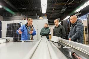 Dr. Bruce King (left) describes the technical capabilities of the solar simulator at Sandia's Photovoltaic Systems Evaluation Laboratory (PSEL) to SunPower representatives Adam Hoffman (second from right) and Fabrizio Farina (right), as RTC Program lead Dr. Laurie Burnham (second from left) looks on.