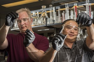 Sandia National Laboratories researchers demonstrate the clarity of patented membranes.