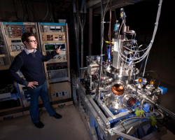 Photo of researcher in the Hydrogen Surface Interactions lab.