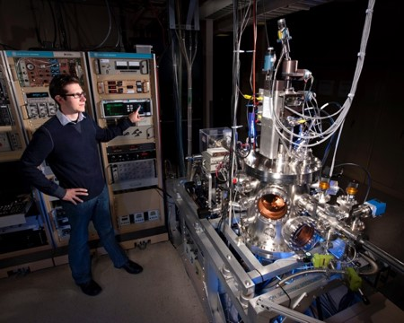 a Sandia researcher and research equipment