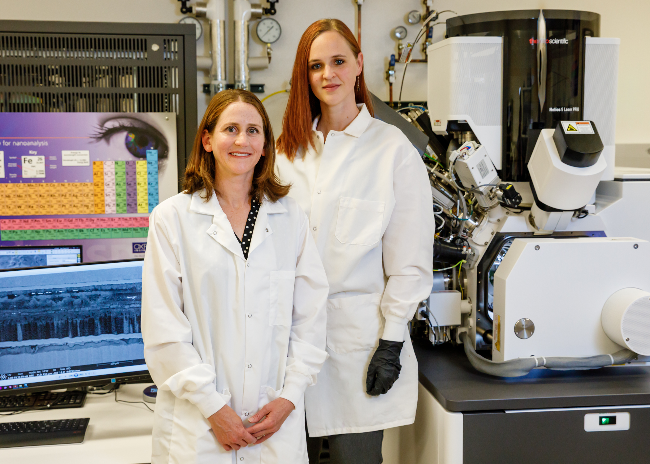 Sandia National Laboratories scientists Katie Harrison, left, and Katie Jungjohann have pioneered a new way to look inside batteries to learn how and why they fail. (Photo by Bret Latter)