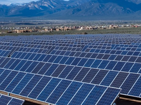 Image of PV Panels and mountains in background
