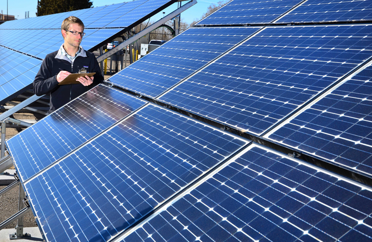 Sandia researcher Geoff Klise worked with Solar Power ElectricTM to develop a tool that can be used to appraise photovoltaic installations on homes and businesses. (Photo by Randy Montoya)