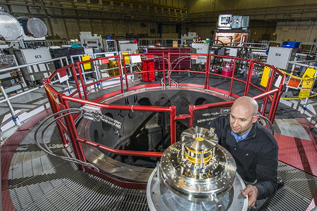Sandia physicist Thomas Awe examines the Helmholz coils that reduce plasma instabilities in the quest for controlled nuclear fusion at Sandia's Z Machine. (Photo by Randy Montoya)