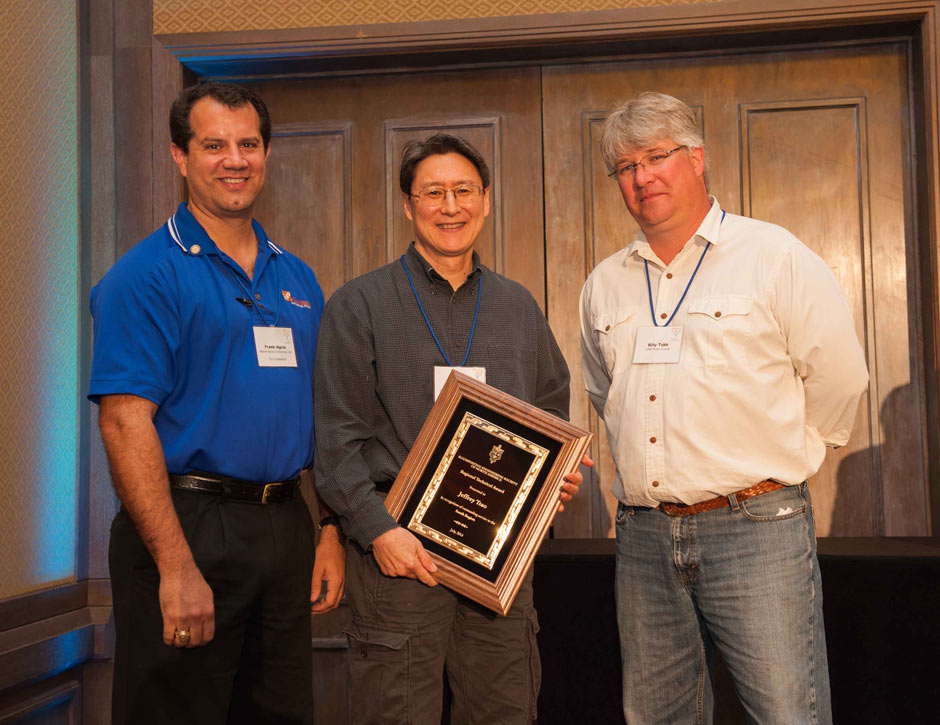 Sandia's Jeff Tsao (center) received his Technical Award from the Illuminating Engineering Society of North America (South Region) at the IES regional meeting in Albuquerque.
