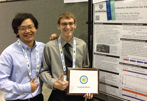 Texas A&M's Zhan Wang (left) and Sandia's Jay Johnson (right) receive their Best Poster award at PVSC.