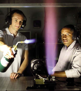 Adam Ruggles (left) and Isaac Ekoto (right) pinpoint the ignition boundary from an unintended release of high-pressure hydrogen gas. Their research provides a scientific basis for establishing separation distances for hydrogen infrastructure. (Photo by Dino Vournas)
