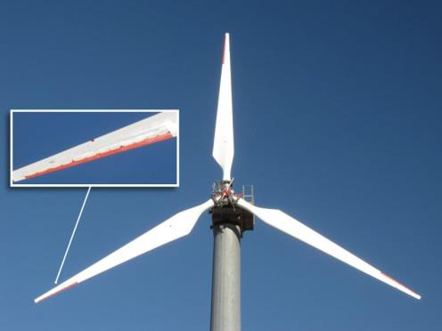 The SMART rotor consisted of three 9-meter blades with trailing edge flaps spanning 20% of each blade. The photo inset is a closer look at the flaps on one blade.