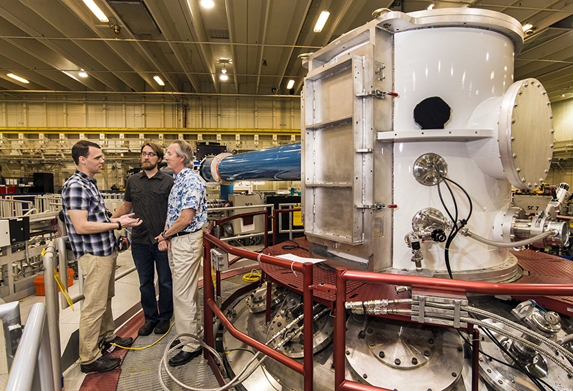At the heart of Sandia's Z Machine, Matt Gomez, left, presents an idea to Steve Slutz, right, while Adam Sefkow looks on. (Photo by Randy Montoya)