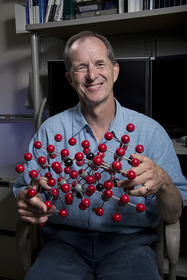 Sandia geoscientist Randall Cygan uses computers to build models showing how contaminants interact with clay minerals. (Photo by Lloyd Wilson)