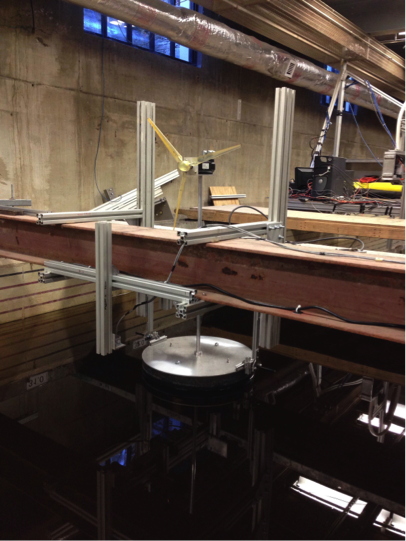 Experimental setup at St. Anthony Falls Labora-tory (SAFL) wave flume for the floating offshore wind-turbine code validation experiments, with a simple floating platform design.